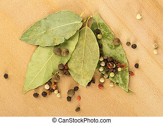 bay leaf, pepper on a wooden background