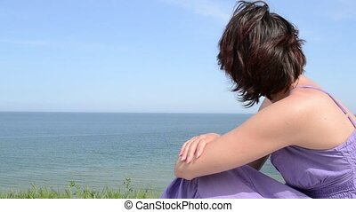 Woman Dreaming on Sea View - Short hair wife is sitting high...