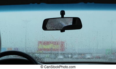 Waiting in the Car in Rain - Inside the car waiting for the...