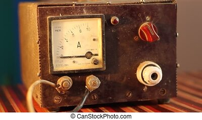 Vintage Electric Charger - Man turns on, step by step, an...