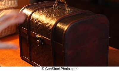 Woman Opens Treasure Chest - On warm lights evening, a woman...
