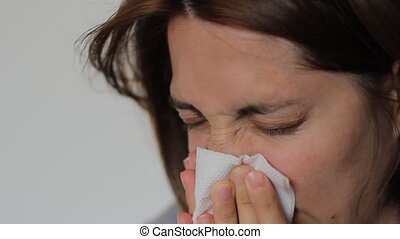 Woman is Blowing Nose - Woman with a flu is blowing her nose...