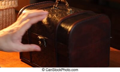 Woman Puts Silver Coin to Chest - Woman opens a antique...