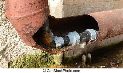 Water Corner Pipe Leaks - A rusty corner pipe leaks slowly....