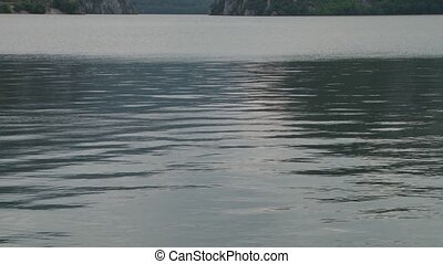 Water Lake Reflections - Lake reflections, wave and ripple...