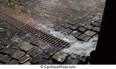 Water Flows through the Drain Trough - Because of a heavy...