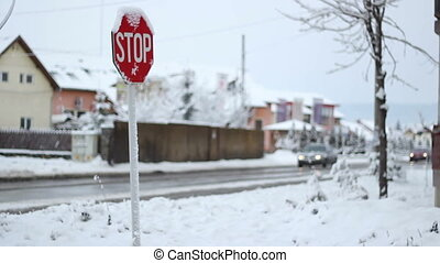 Winter Traffic Sign - Iced STOP traffic sign on a...