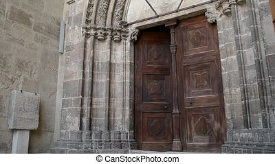 Woman Enters Medieval Door - A woman steps into a Middle...