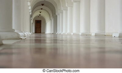 White Corridor with Arches - Low angle shot of a white...