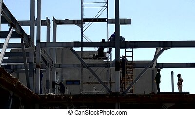 Workers on Construction Site - Workers on site for building...
