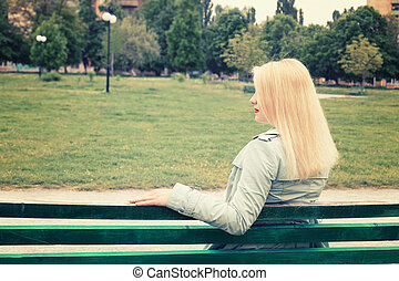 Pregnant woman sitting bench park