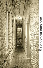 Fear - Long narrow corridor lit by bare light bulbs with a...