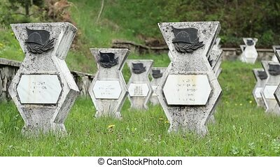 WWII Cemetery - Pan shot with WWII memorial cemetery of...