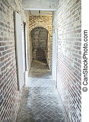 Brick Corridor - Narrow brick hallway with a dark exit at...