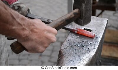 Wrought Iron Craftsman Work - A blacksmith hammer the...