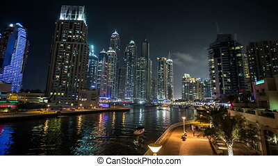 Dubai Marina with skyscraper - time lapse photography,...