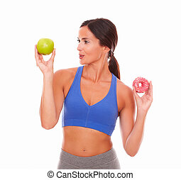Sporty adult woman smiling at fruit