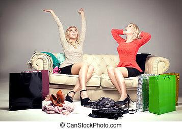 Two young beautiful girls enjoying shopping. Happy friends.