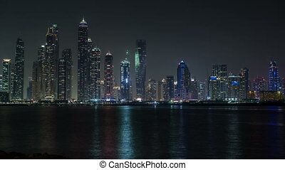 night view of Dubai skyscraper - time lapse photography...