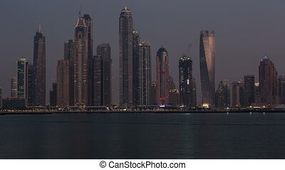 sunset view of Dubai skyscraper in United Arab Emirates UAE,...
