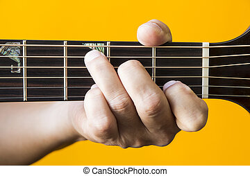 C major chord on guitar - Hand performing C major chord on...