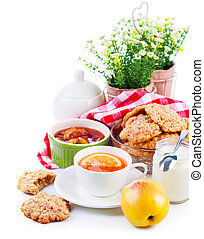 Breakfast with tea and fresh cookies Isolated on white...