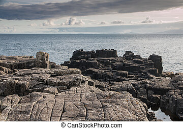 Neist Point basalt rocks - Grey and black basalt rocks at...