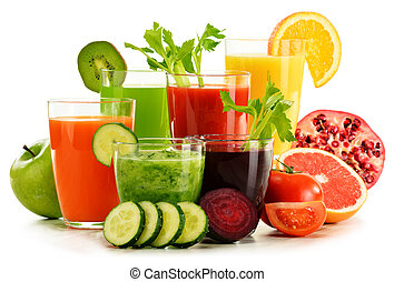 Glasses with fresh organic vegetable and fruit juices on...