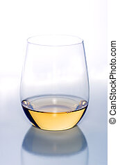 Glass of white wine in stemless wine glass
