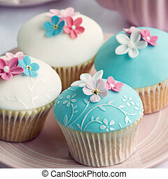 Wedding cupcakes with embossed fondant