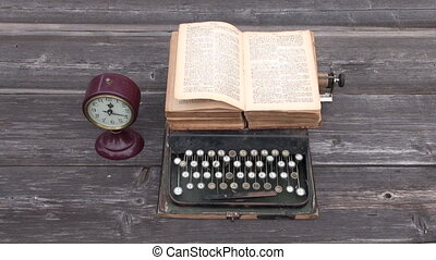 ancient typewriter and old Bible book on wooden background....