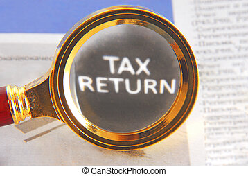 tax return and magnifying glass