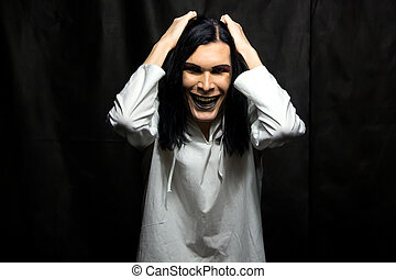 Image of mad man with make up on black background