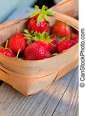 red strawberries in twiggen basket - red rich strawberries...