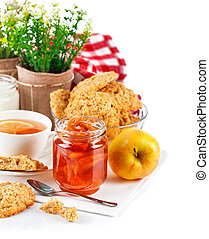 Breakfast with tea jam and fresh cookies Isolated on white...
