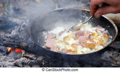 An unusual way of cooking eggs on fire - Removed process of...