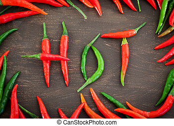 Hot word made from red and green chili pepper - Hot word...