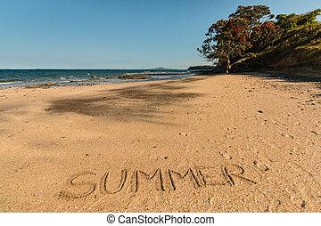 word Summer written in sand