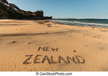 New Zealand written in sand