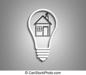 Electric light bulb and house inside it as symbol of green...