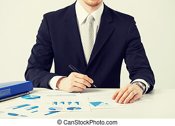 businessman working and signing with papers - picture of...