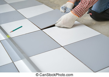 Installing ceramic tiles on a floor - Tiler install ceramic...