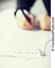 man hands with gambling dices signing contract - picture of...