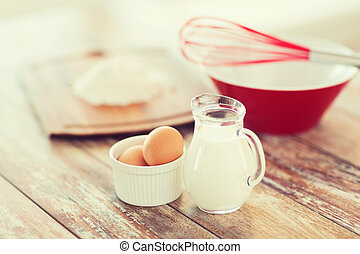 jugful of milk, eggs in a bowl and flour - cooking and food...