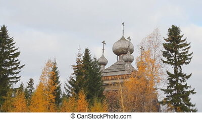Ancient Russian Church in the autumn forest - Very old...