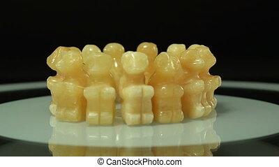 Aragonite monkeys rotating - Hand carved yellow aragonite...