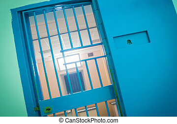 bars in old prison . Blue Duress .