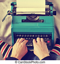 young man typewriting, with a retro effect - a young man...