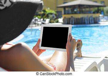 Woman with tablet at swimming pool - Woman with tablet pc...