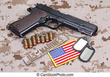colt 1911 handgun on USMC camouflage uniform